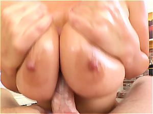 Jayden Jaymes wraps her udders around a meaty pipe