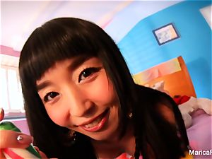 japanese star Marica Hase plays with candy prick