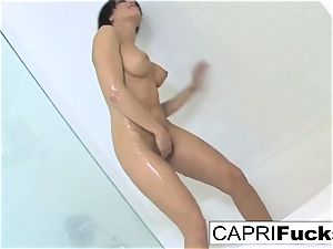 Capri likes to finger her cock-squeezing twat