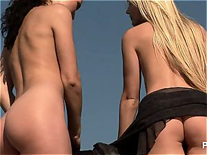 two nude chicks on the wall