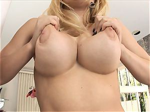 blond stunner Kagney Karter plays with her giant cupcakes