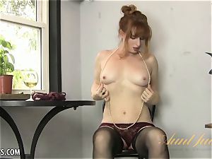 Amber Dawn delights herself wearing hip highs.