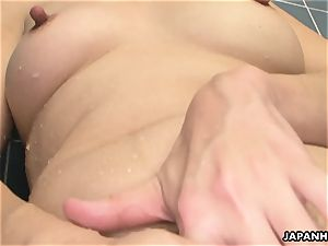 Solo big-titted asian doofy fumbling on her wet muff