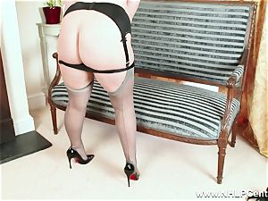 curvaceous blondie jacks in grey nylons and high high-heeled slippers